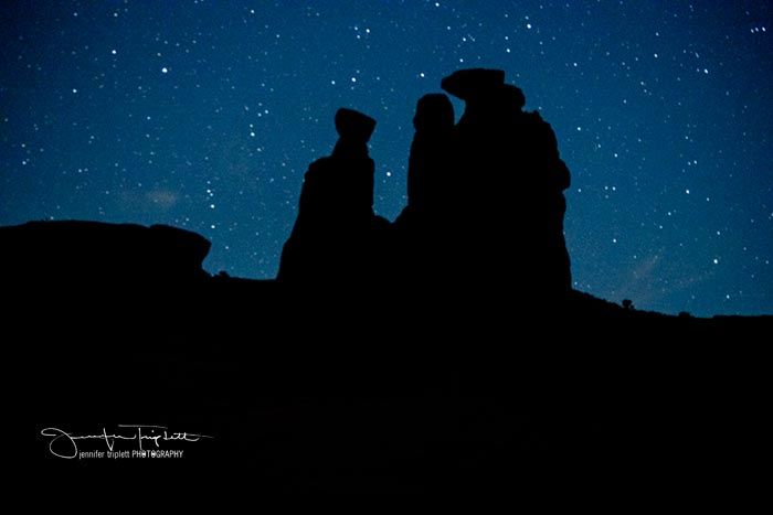 Arches night sky with stars and silhouette by Jennifer Triplett
